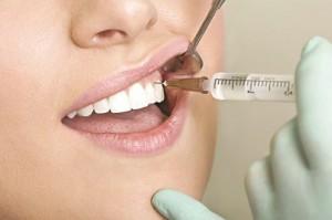 Những điều cần làm sau khi nhổ răng khôn - Ảnh 1