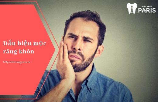 Đau nhức là dấu hiệu hay gặp khi mọc răng khôn